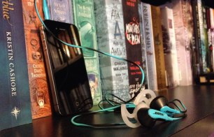 Image: iPhone with Headphones on Bookshelf