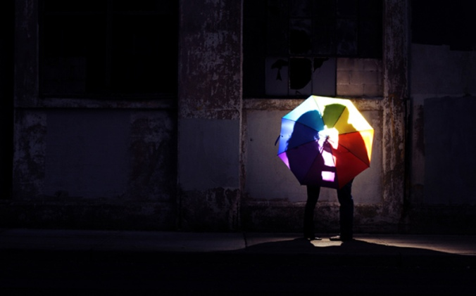 Kissing Behind Umbrella