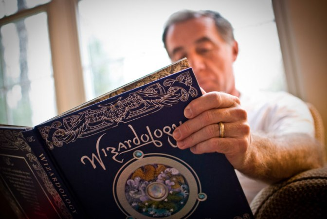 Image: Man Reading Wizardology Book