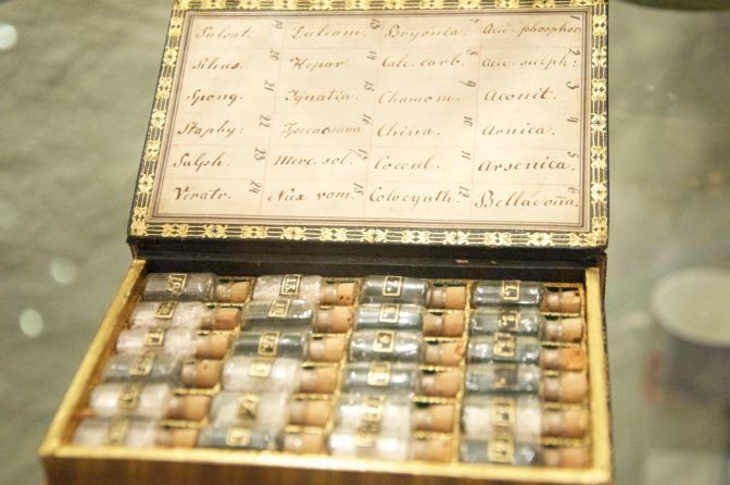 Image: Box of old vials containing medicinal and poisonous substances.