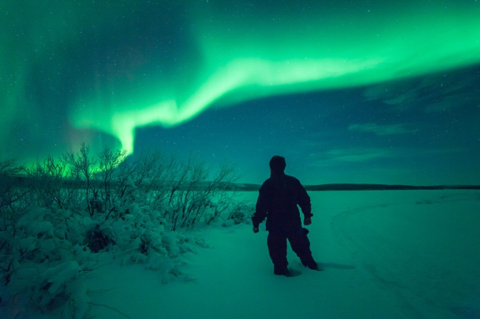 Image: Northern Lights Figure Standing in Snow
